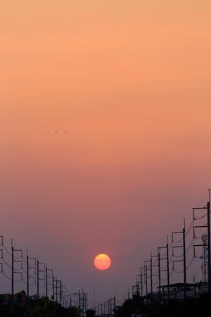 electricity pole: Electricity pole at sunset Stock Photo