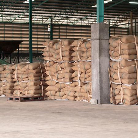 food shop: Hemp sacks containing rice in warehouse Editorial