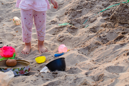 beach feet: Little girl foot step on sandpit