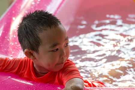 little boy swimming: Little boy swimming in big swimming pool