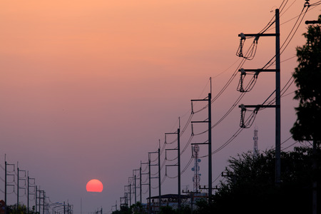 electric grid: Electricity pole at sunset Stock Photo