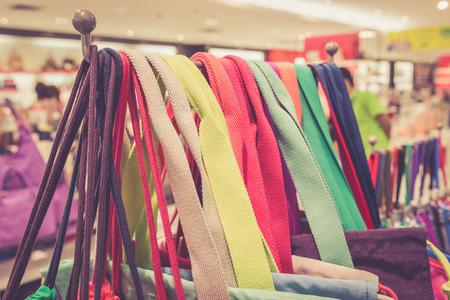 strap: Shoulder strap bag hanging for sale in department store