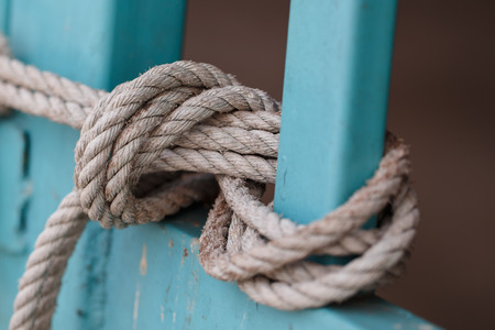 bonding rope: Close up of old rope knotted.