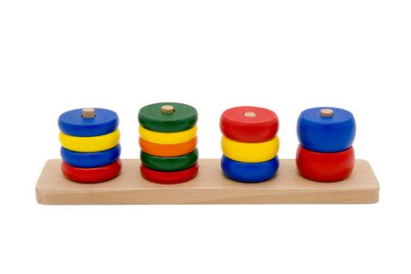 building color: Wooden toys as a puzzle with different shapes isolated on white background