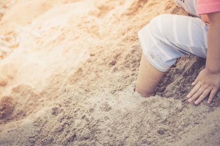 sandpit: Little boy foot step on sandpit, warm retro style