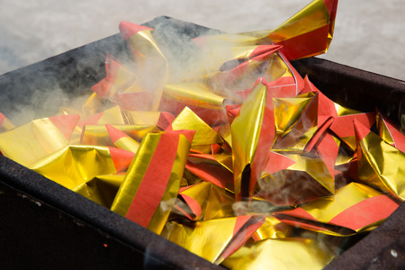 Chinese burning the offering in traditional cremation. Stock Photo