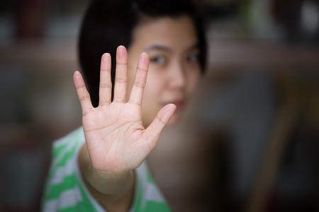 disallow: Beautiful asian woman with stop gesture. Stock Photo