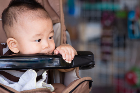 superstore: Baby boy sitting stroller in superstore