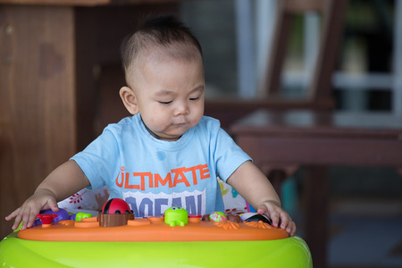 asian ancestry: Little baby boy  in the baby walker Stock Photo