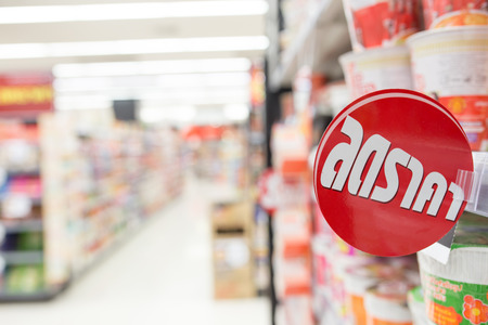 adboard: Red and white sale sign indicating a discount in supermarket Stock Photo