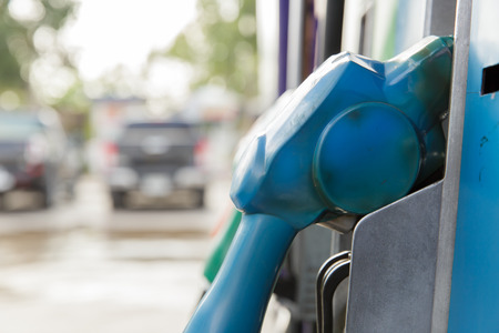 fueling pump: Gas pump nozzles in a service station Stock Photo