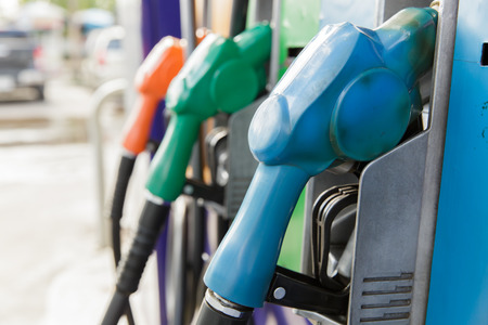 unleaded: Gas pump nozzles in a service station Stock Photo