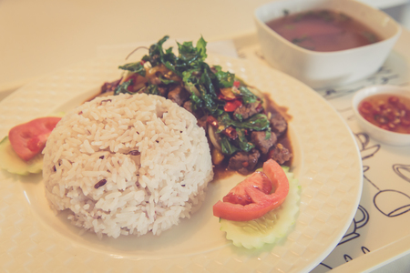 rice plate: Chilli beef with crispy fried basil leaves, served with brown rice ,tomato and cucumber