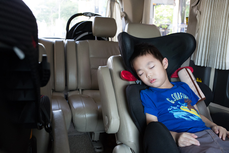 buckled: Young boy sleeping in the carseat