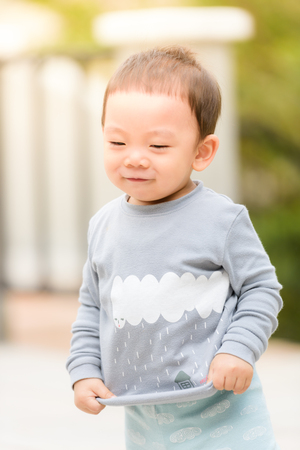 hapy: Portrait of hapy little boy on background summer park