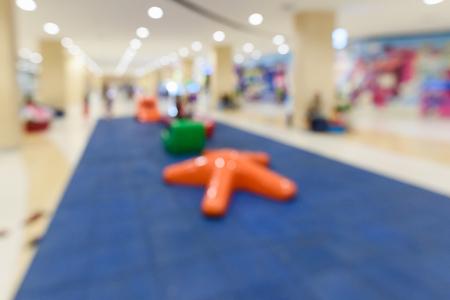 Abstract blur children playground corner in mall as background