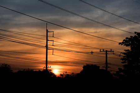 Electric post and color of sky at sunset time.