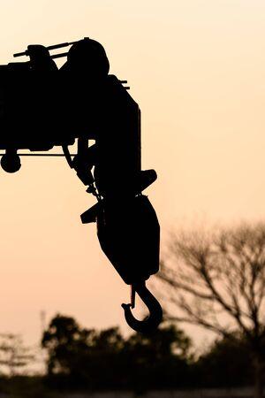 silhouette hook of crane sunset background 스톡 콘텐츠