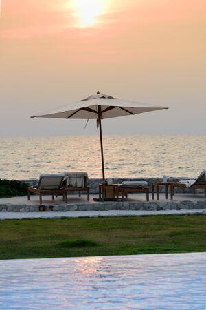 empty chairs under umbrellas on a sandy beach