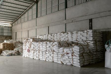 Hemp sacks containing rice in warehouse 에디토리얼