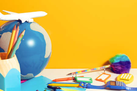tourist student kids travel and education with earth globe map and airplane toy in back to school concept