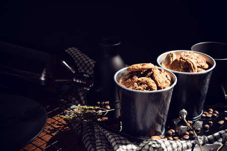 cookies biscuit sweet dessert bakery in vintage food dinner and coffee bean with decoration prop on wood table dark style Standard-Bild