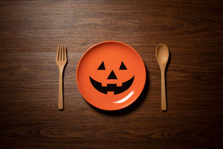 halloween holiday dinner prop decoration with spoon and dish on wood table background