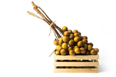 longan isolated white background fruit in wood box