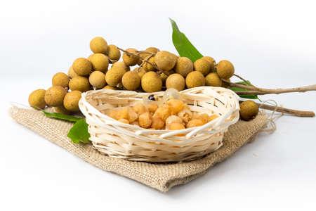longan isolated white background fruit in wood basket rattan