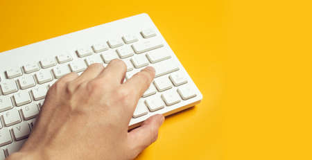 businessman hand on typing keyboard computer, screwdriver in top view flat lay workspace table, digital data security privacy network for business concept