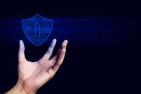 human hand with floating of anti-virus computer shield logo icon in security privacy protect technology network concept Stock fotó