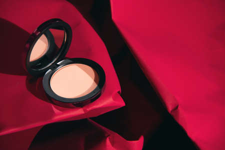 red rose color of beauty fashion makeup cosmetic powder pact product package mockup on paper texture Stock Photo