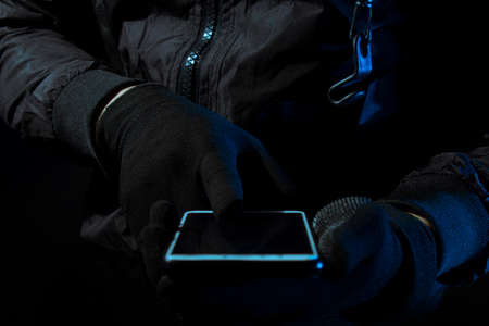hacker robbery terrorist with tablet smartphone computer attack to server network system online in data internet security