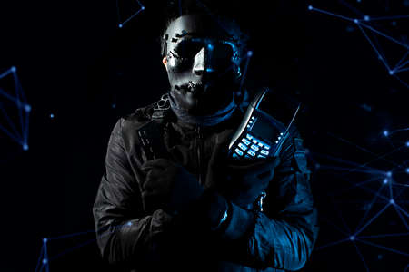 hacker robbery terrorist with espionage credit card and device reader network system online in data internet security, financial safety
