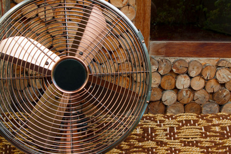 oscillation: Beautiful antique  fan on a wooden backgrounds Stock Photo