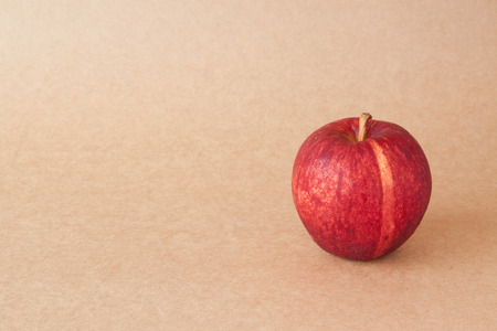 brown paper background: red apples on brown paper background