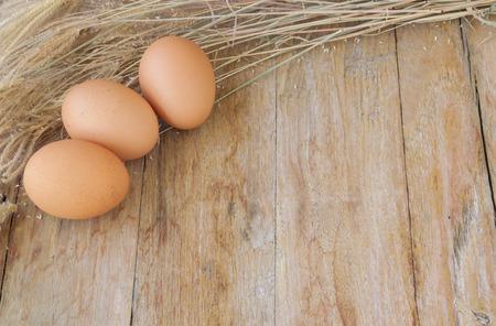 brown eggs: Chicken brown eggs on wooden background
