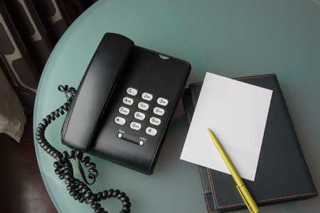 paper note: black telephone with paper note