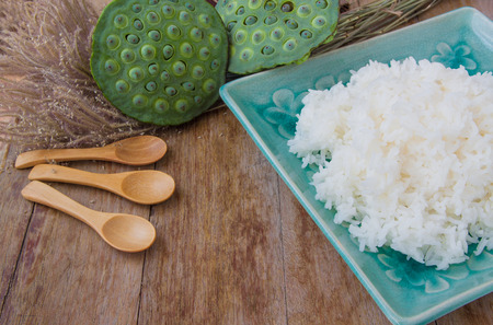 rice plate: Rice in a green dish on wooden background