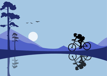 mountain silhouette: young man riding bicycle on nature backgrounds