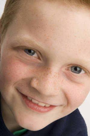 young boy smiling: Close Up of young Boy smiling