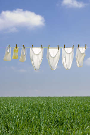 disinfect: Clothes drying in the summer breeze on clear blue sky with soft clouds