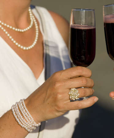 toasting with red wine Фото со стока