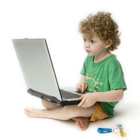 powerbook: child staring at laptop against white background
