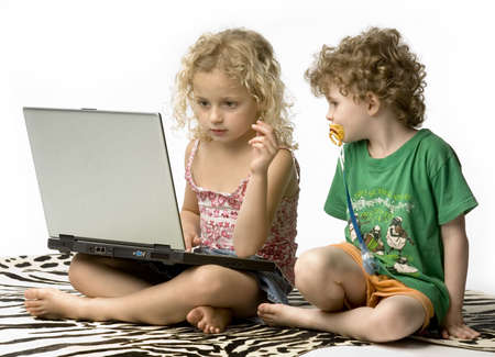 powerbook: children staring at a laptop against white background Stock Photo