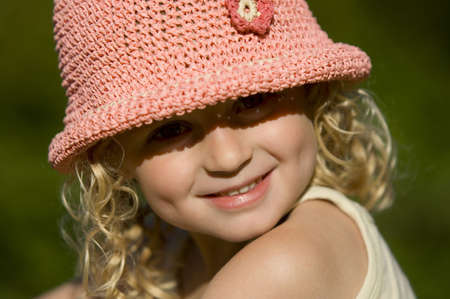 Portrait of attractive young girl smiling , white pink hat Stock Photo