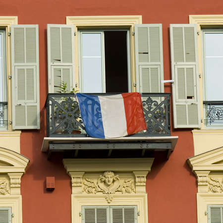 typical front of house in Nice with french flag on a balcony Stock Photo - 555585