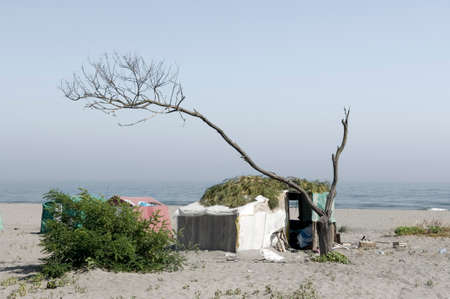 shantytown: Poor camp on the beach Stock Photo