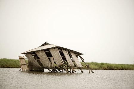 stilt house: Collapsed stilt house on the lagoon of Ganvie in Benin Stock Photo