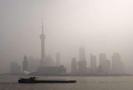 shanghai pudong skyline: air pollution over Shanghai, a barge is passing